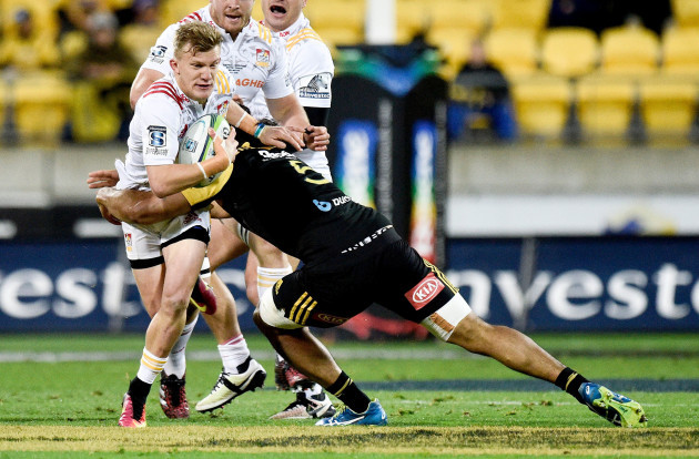 Damian McKenzie is tackled by Michael Fatialofa