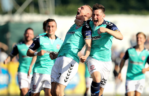 Ronan Cutis celebrates scoring their second goal of the game with Conor McDermott