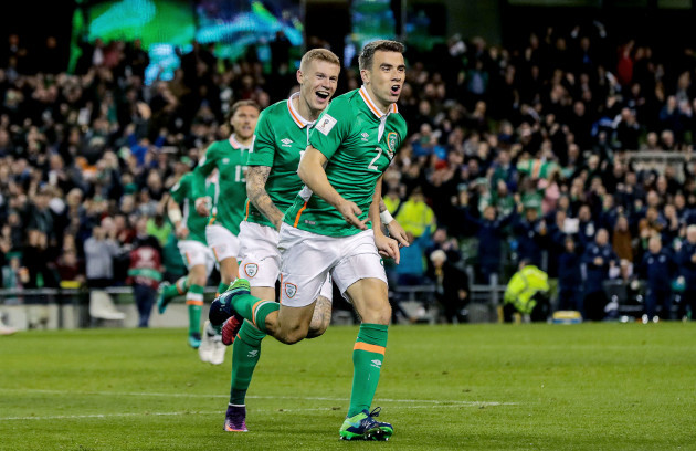 Seamus Coleman celebrates scoring a goal with James McClean