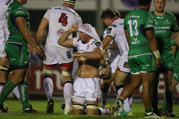 Ulster's Roger Wilson loses his shirt as behind him Rory Best scores a try