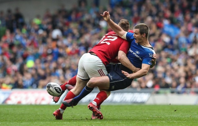 Leinster's Jonathan Sexton is tackled by Munster's Rory Scannell