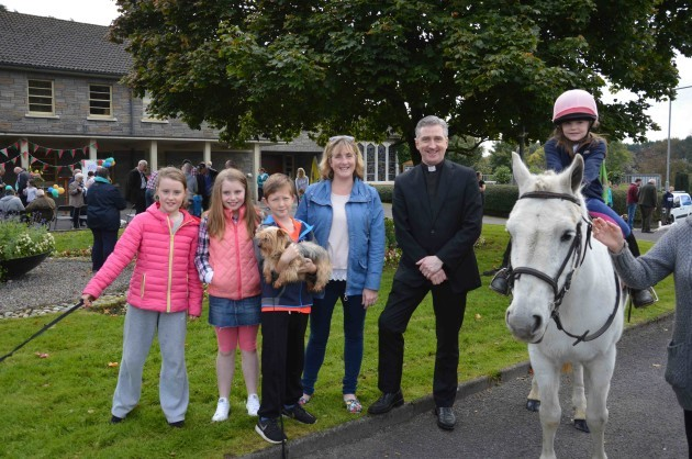 Lily Slattery with her pony 'Dancer' pictured with family and Fr. Richard Gibbons low res