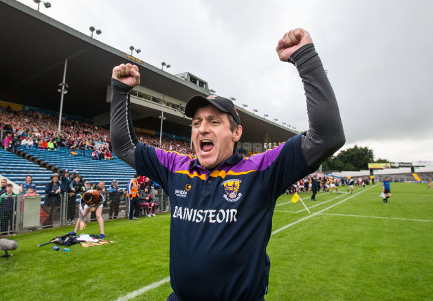 Liam Dunne celebrates at the final whistle