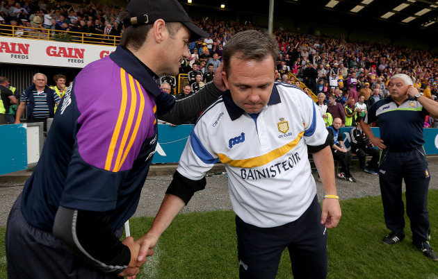 Davy Fitzgerald and Liam Dunne at the end of the game