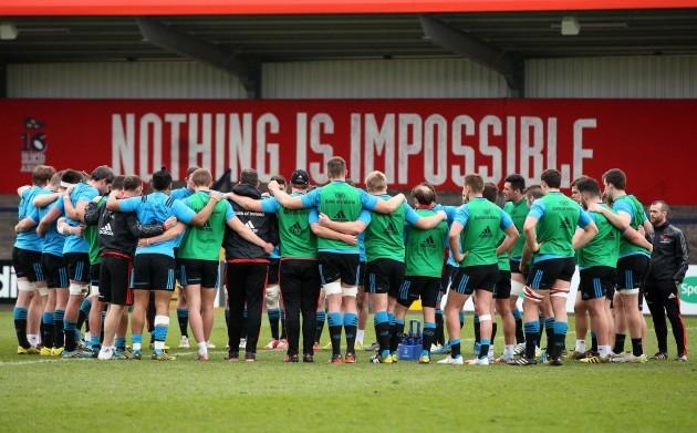 Munster team huddle during training
