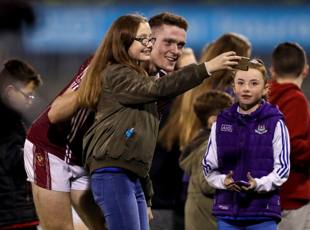 Brian Fenton takes photos with fans after the game