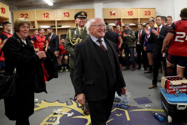 Michael D. Higgins visits the Munster dressing room after the game