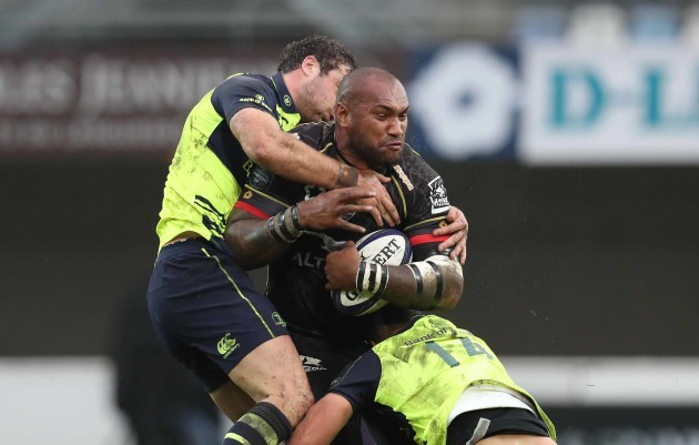 Montpellier's Nemani Nadolo  is tackled by Leinster's Garry Ringrose  and Zane Kirchner