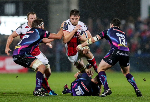 Iain Henderson is tackled by Gareth Steenson, Geoff Parling and Ian Whitten