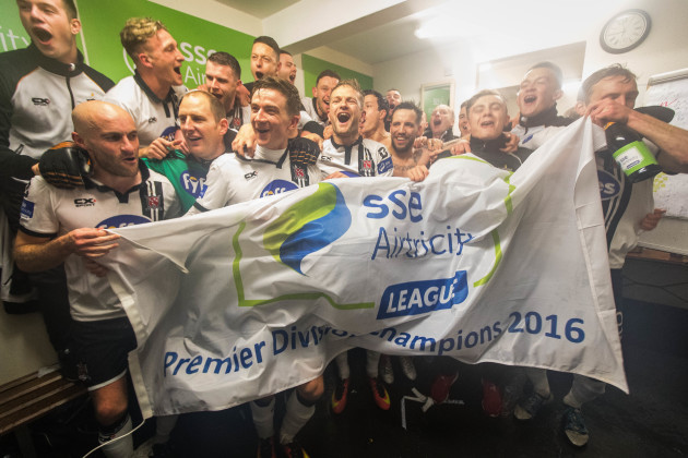 Dundalk celebrate winning the league in the dressing rooms after the game