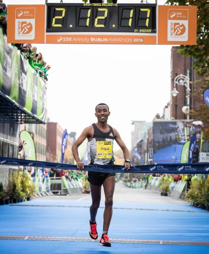 Dereje Debele Tulu from Ethiopia crosses the line to win the Dublin Marathon