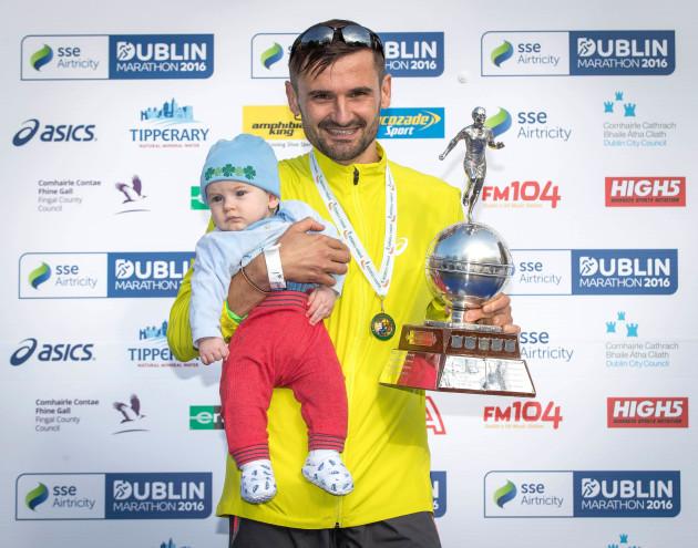 Sergiu Ciobanu celebrates winning the Irish National Championship with his son Daniel