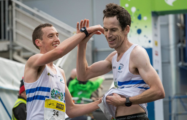 Competitors share a joke after finishing the Dublin Marathon