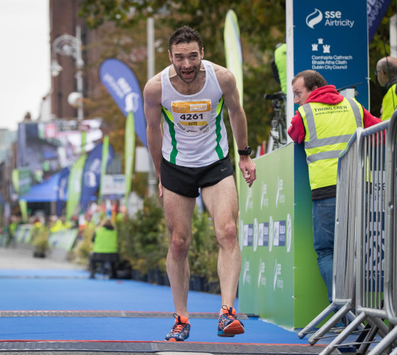 A competitor finishes the Dublin Marathon