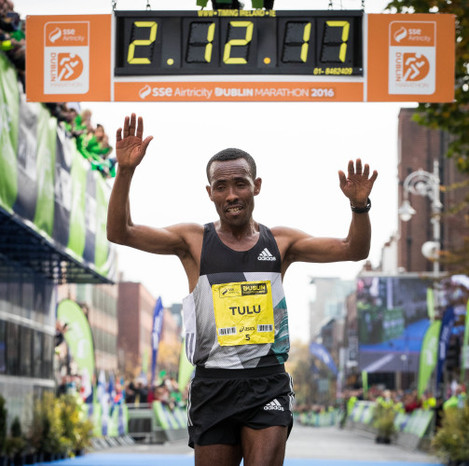 Dereje Debele Tulu from Ethiopia crosses the line to win the Dublin Marathon