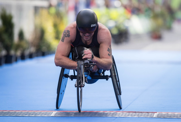 Patrick Monahan crosses the line to win the Wheelchair race during the Dublin Marathon