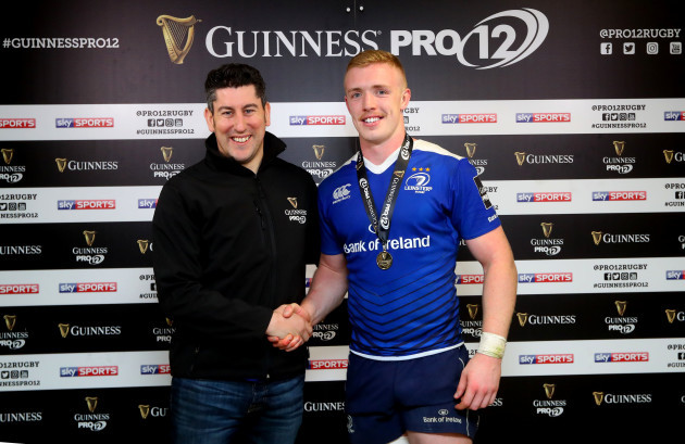 Dan Leavy presented with the man of the match award by Padraig Fox of Guinness