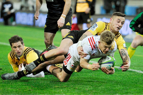 Damian McKenzie is taken out of play by TJ Perenara