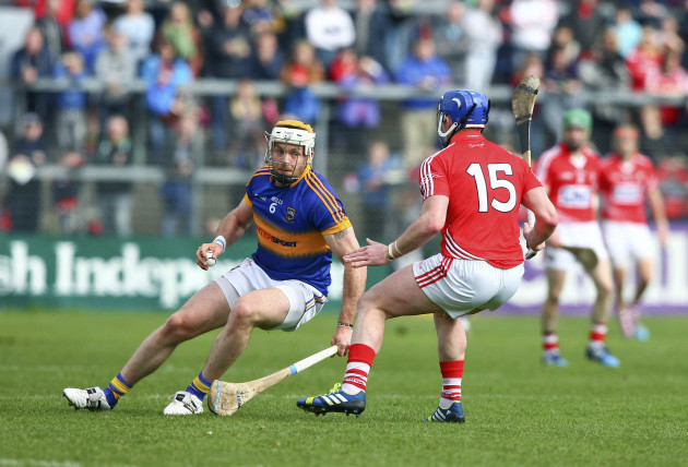 Padraic Maher in action against Patrick Horgan