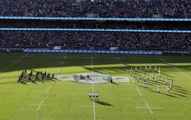 Ireland team face the Haka in a shape of eight in memory of Anthony Foley of Munster