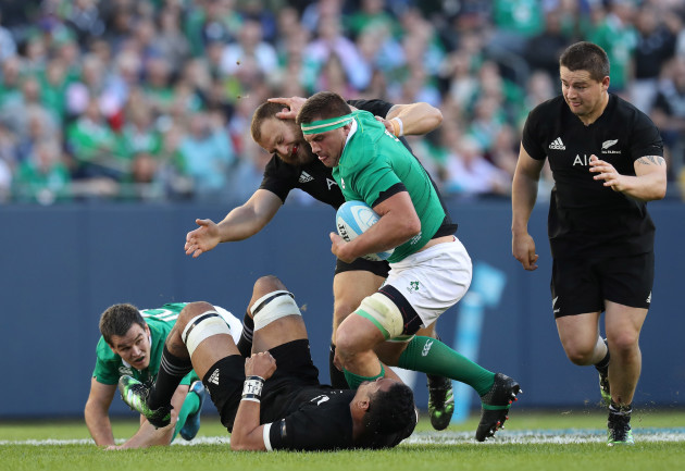 Ireland's CJ Stander is tackled by New Zealand All Blacks's Jerome Kaino and Joe Moody