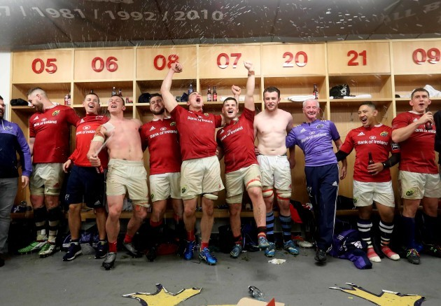 The Munster team celebrate winning