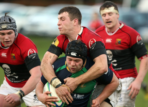 Johnny Murphy is tackled by Conor Barry