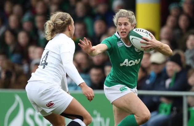 IrelandÕs Alison Miller is tackled by EnglandÕs Kay Wilson