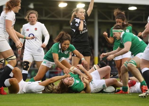 IrelandÕs Sene Naoupu celebrates with try scorer Nora Stapleton