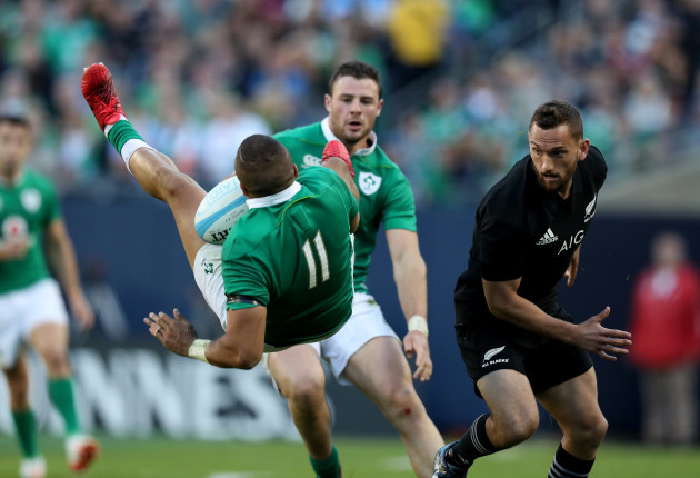 Ireland's Simon Zebo is tackled by New Zealand All Blacks's Aaron Cruden
