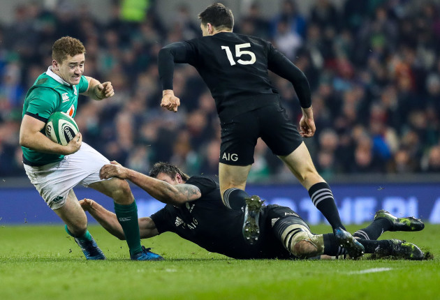 Paddy Jackson tackled by Liam Squire