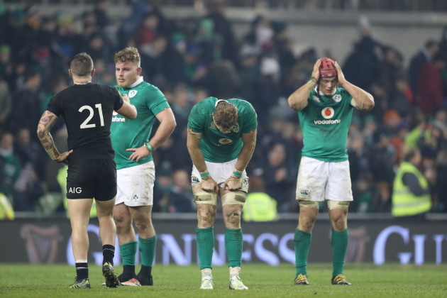 Finlay Bealham, Jamie Heaslip and Josh van der Flier dejected after the game