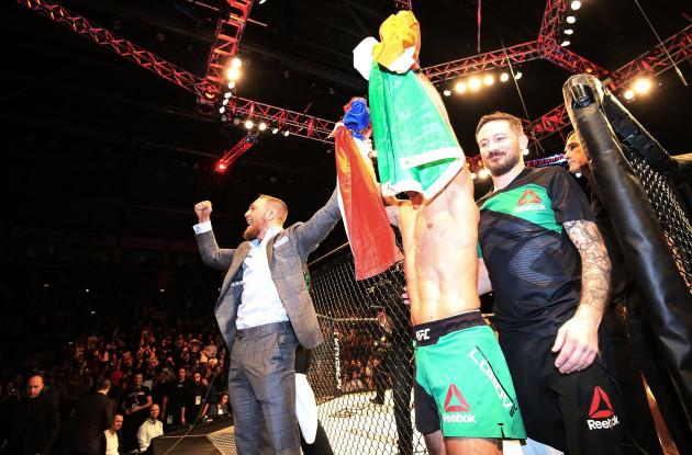 Conor McGregor celebrates with Artem Lobov following his victory