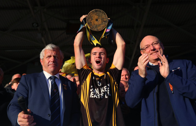 Stan Lineen lifts the trophy