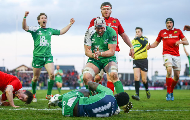Kieran Marmion and Eoin McKeon celebrate with try scorer Niyi Adeolokun