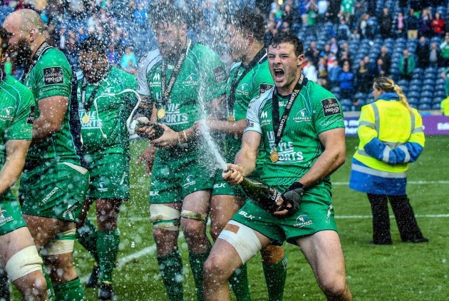Robbie Henshaw celebrates with champagne after the game