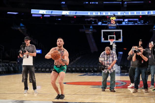 Conor McGregor scores a basket