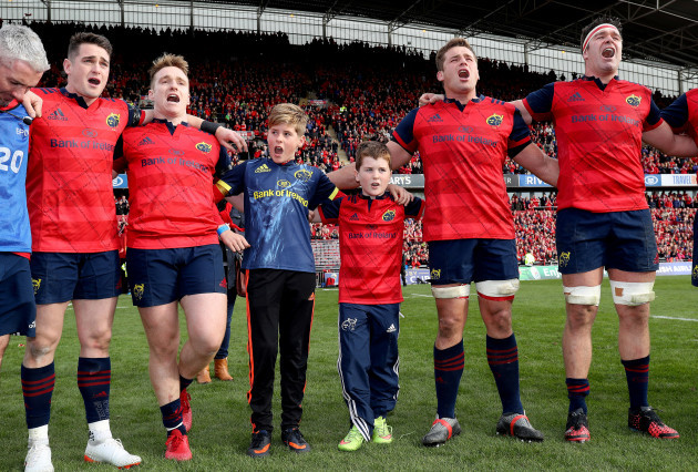 Tony and Dan Foley, sons of the late Anthony Foley sing with the Munster players after the game