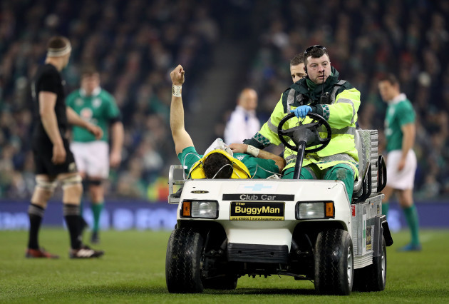 Robbie Henshaw salutes the crowd while leaving the field with an injury
