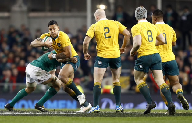 Israel Folau is tackled by CJ Stander