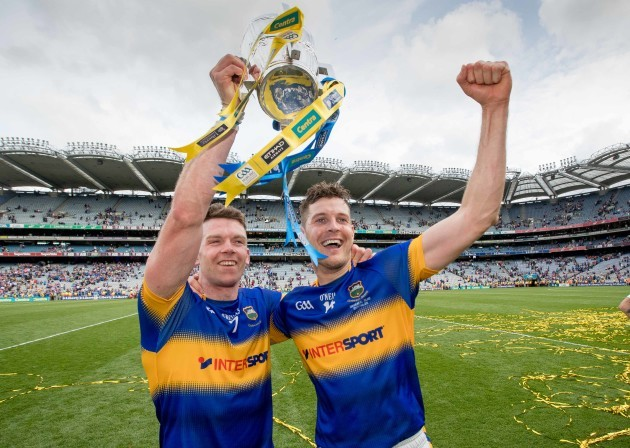 Padraic Maher and Seamus Callanan celebrate with the Liam McCarthy Cup