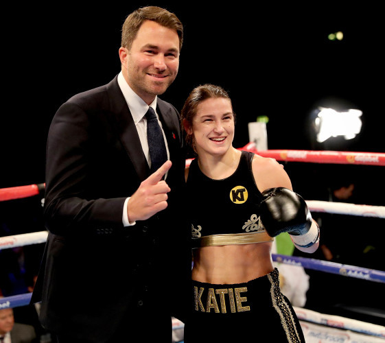 Katie Taylor celebrates her win with Eddie Hearn