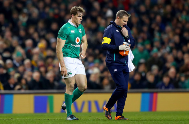 Andrew Trimble leaves the field injured with physio James Allen