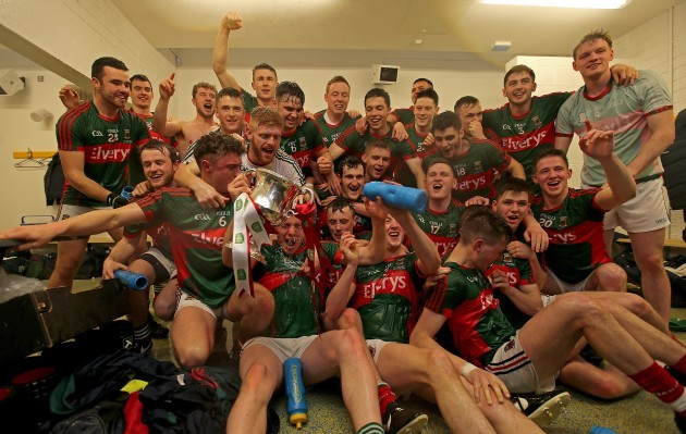 The Mayo team celebrate in the dressing room