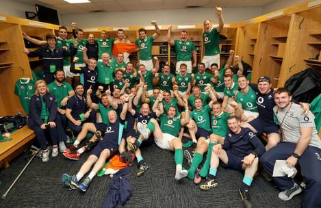 The Ireland team and management celebrate winning