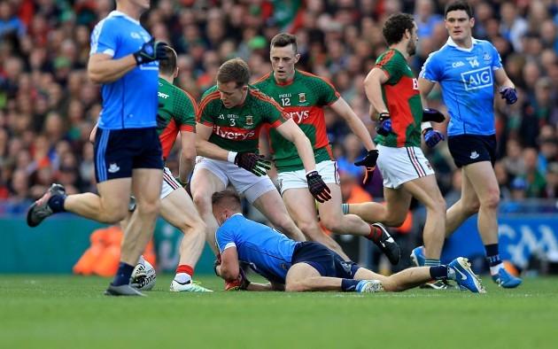 Jonny Cooper holds back Donal Vaughan