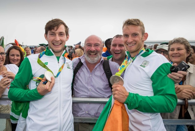 Paul and Gary O'Donovan celebrate winning a silver medal with father Teddy and brother David O'Donovan