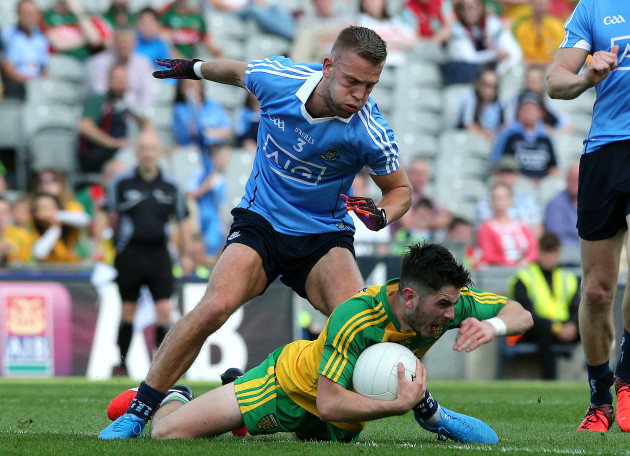 Jonny Cooper tackles Ryan McHugh