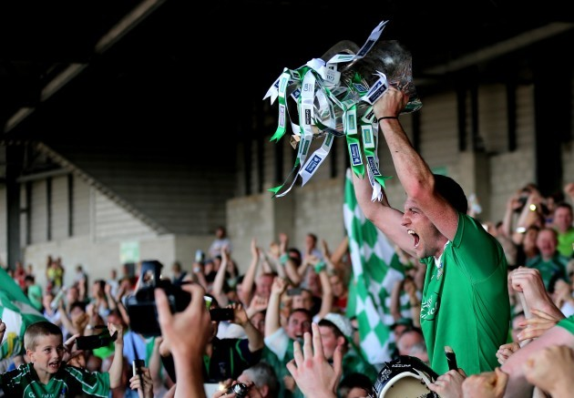 Donal O'Grady lifts the trophy