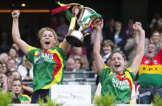 Teresa Meaney and Marian Doyle lift the trophy